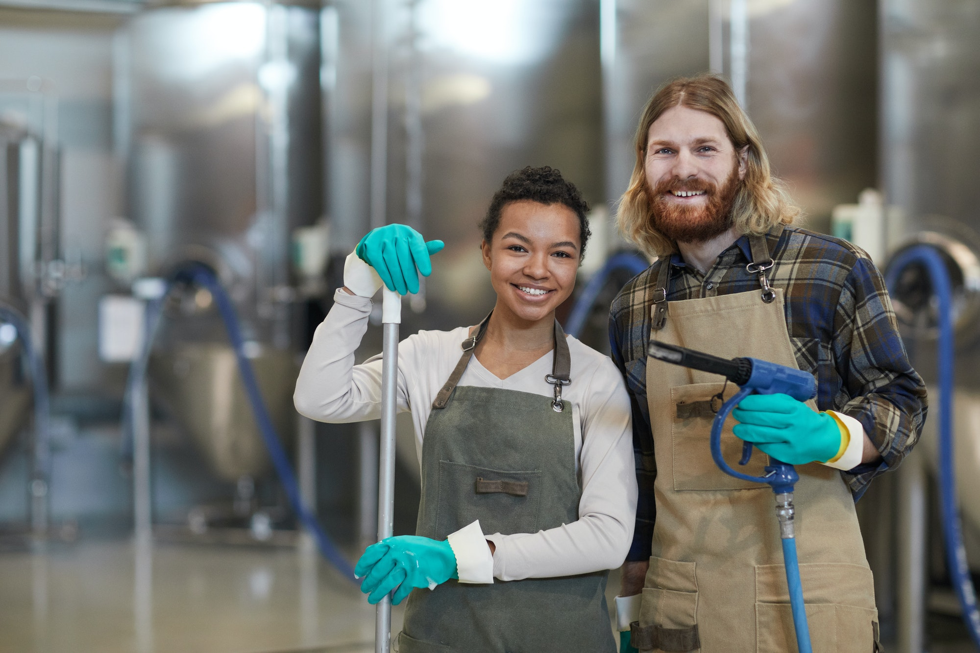 two-cleaning-workers-smiling-at-camera.jpg